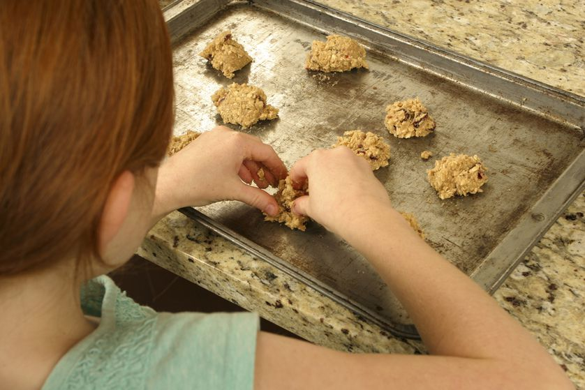 Make something that your kids will want to try, like cookies, homemade pizza, or muffins.