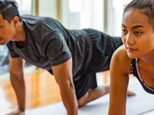 Man and woman working out at home.