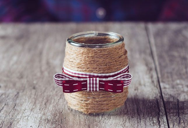 Wrap a jar in twine with ribbon and tuck a votive candle inside for a cozy-looking holiday craft.
