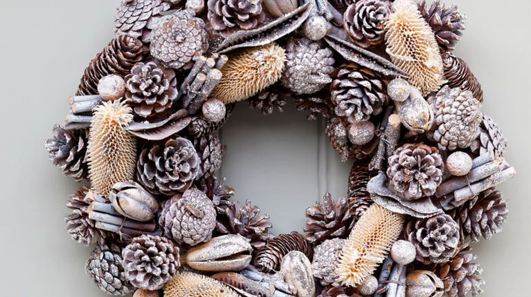 Transform a tired old wreath with a little glitter spray.