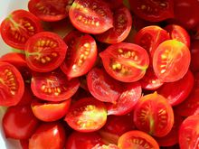 Cut cherry tomatoes in a bowl