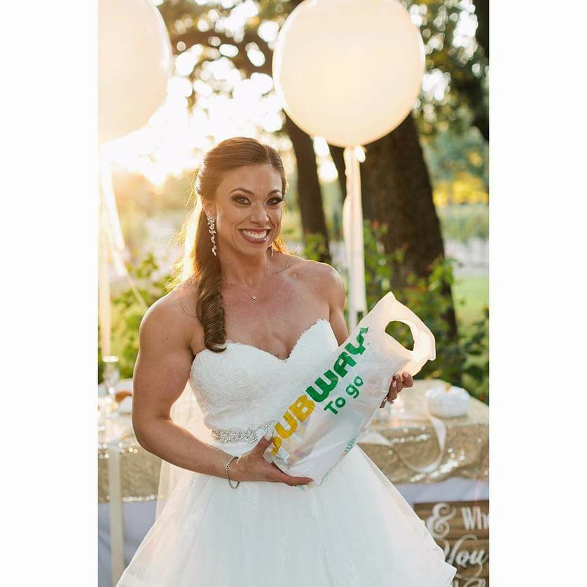 Chrissy Wells with a Subway sandwich on her wedding day