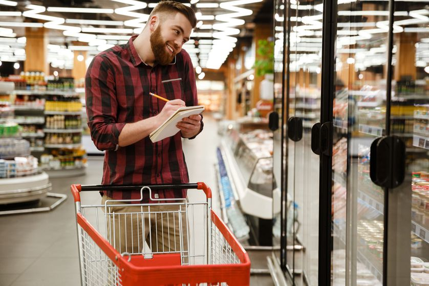 Man in grocery store with list
