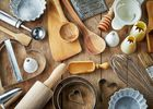 Various kitchen utensils on wooden table