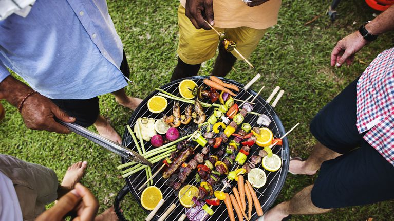 Foods on a hot grill outside in the summer