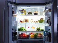 Open refrigerator at night