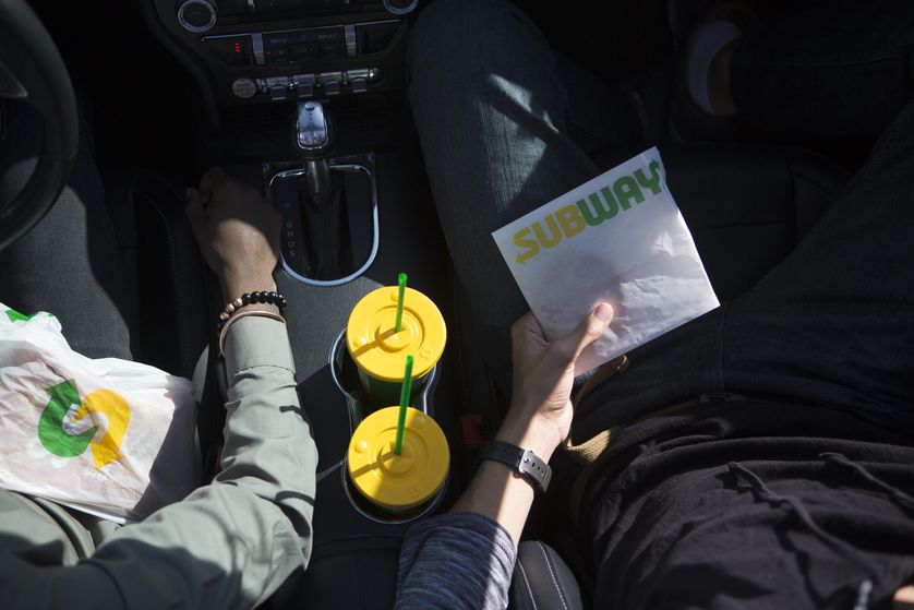 Subway sandwiches and cookies are great for sharing on the road.