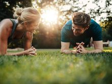 Man and woman exercising outside
