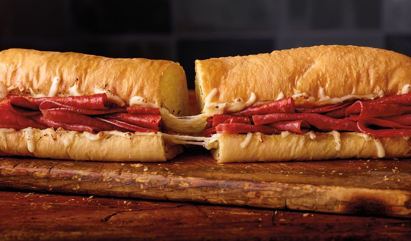 Our Spicy Italian sandwich is unbelievably delicious on Ultimate Cheesy Garlic Bread.
